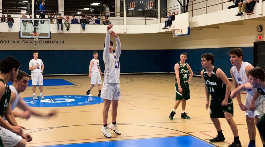 Boys playing indoor basketball