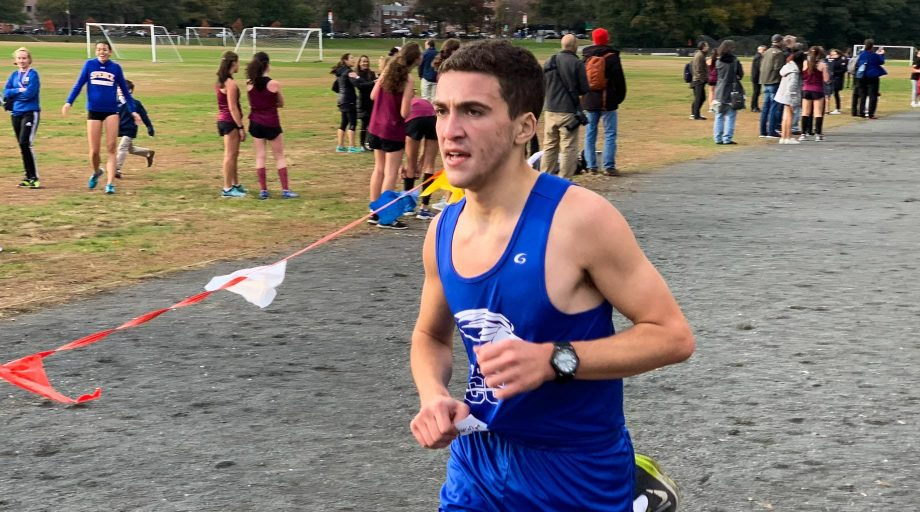 Male student competing in cross country race