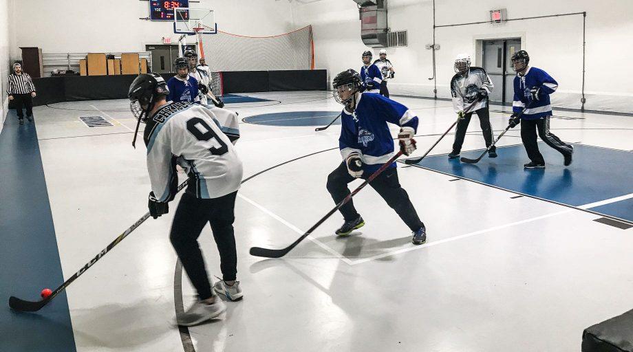 Playing indoor hockey