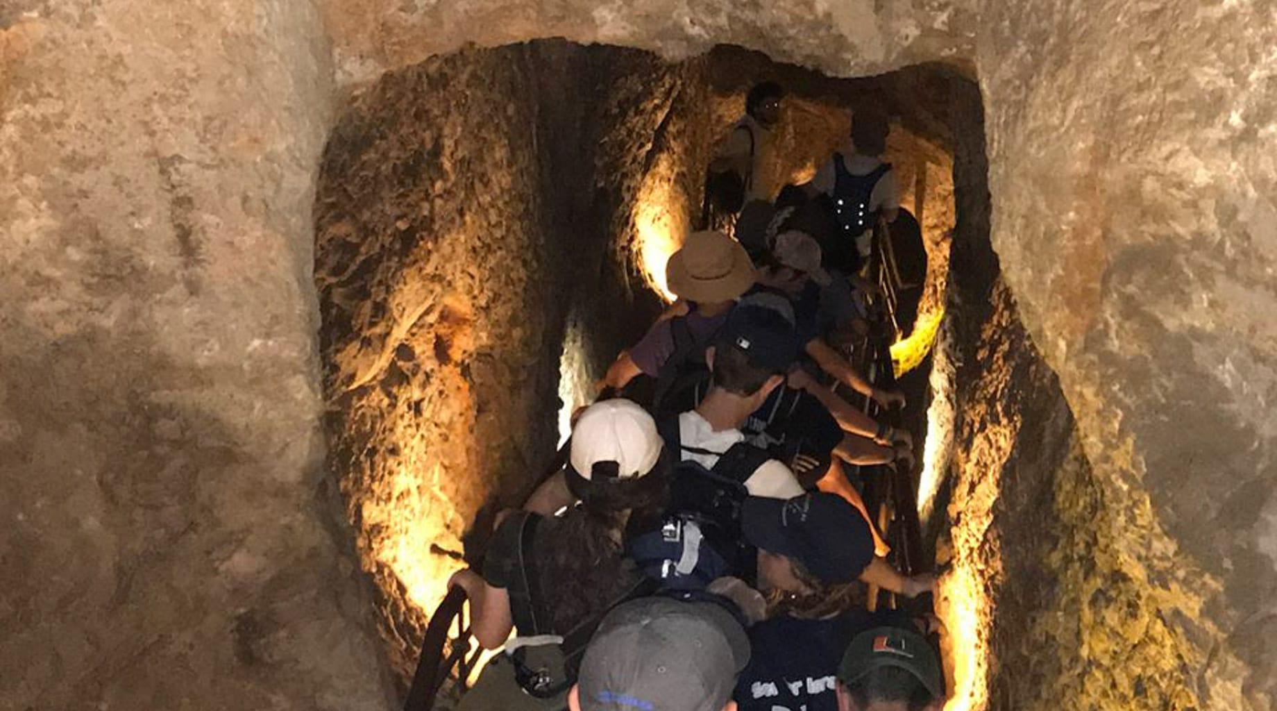 Students exploring Israeli caves