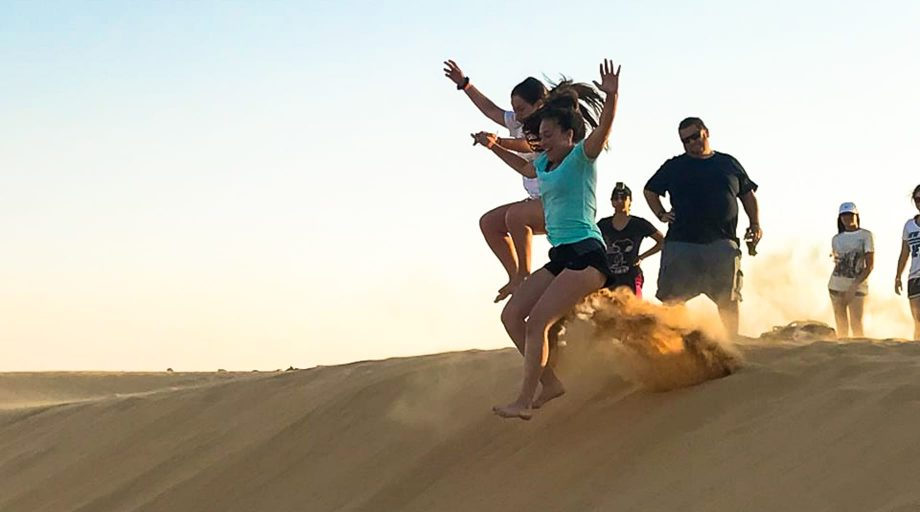 Jumping off sand dunes in Israel