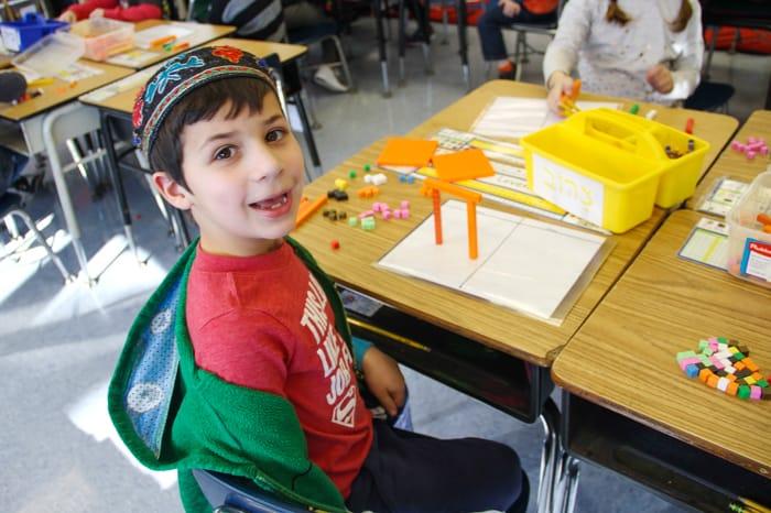 Lower school boy in math class