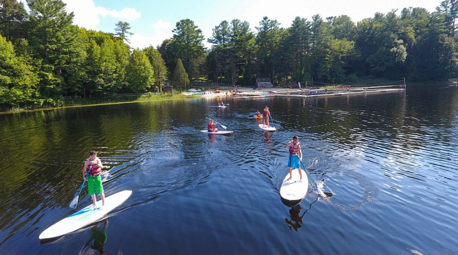 Stand up paddleboarding at the retreat
