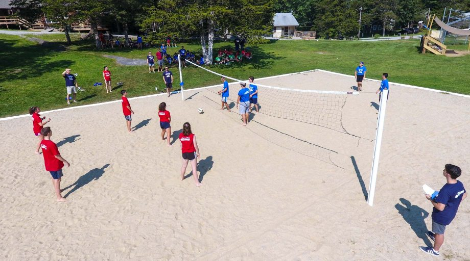 Playing volleyball on a sand court during the retreat