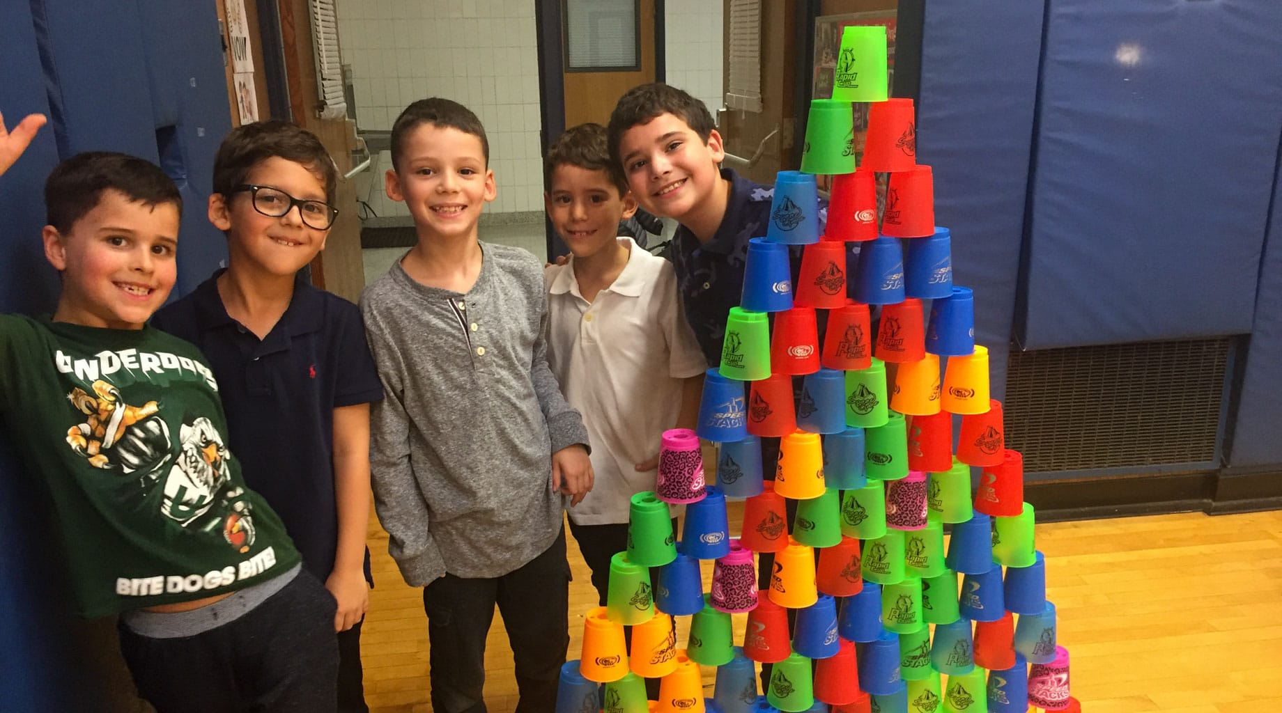 Lower school boys stacking cups