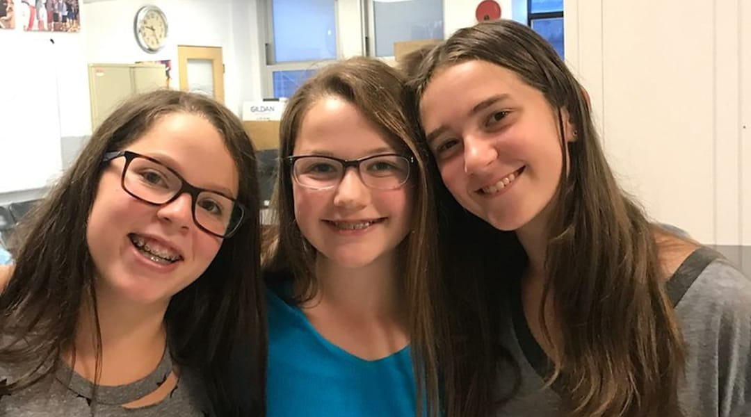 Three female students smiling